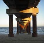 photo under an ocean peer bridge